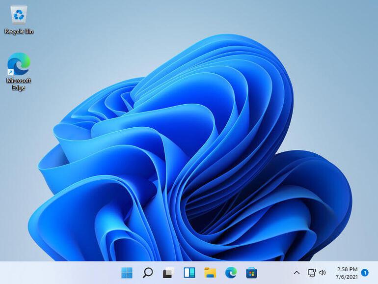 Рабочий стол с обновленной панелью задач и расположением иконном программ по центру